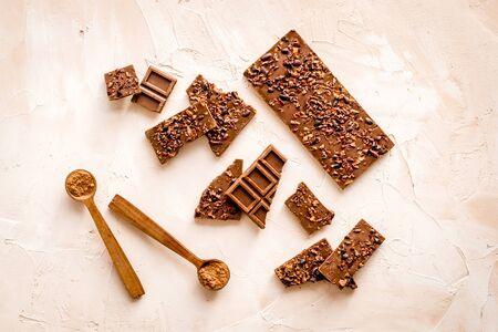 Homemade chocolate. Bars and broken pieces on light table 版權商用圖片