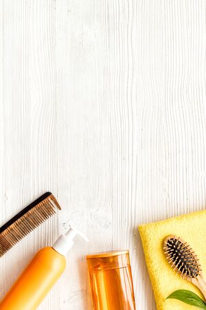 Bath cosmetics for hair. Shampoo, and balm on white background top-down frame copy space