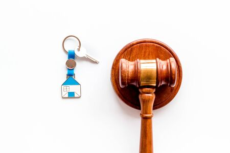 Property auction concept. Judge gavel near house on white background top-down.