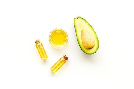 Avocado oil - skin care concept - on white background top-down Stock Photo