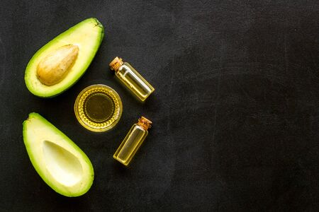 Avocado oil - skin care concept - on black background top-down frame copy space Stock Photo