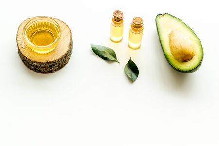 Avocado oil - for hair and nails care - on white background.