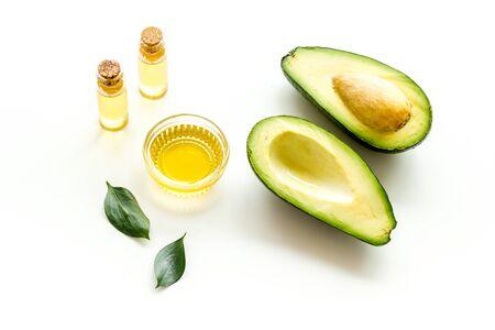 Avocado oil - ingredient for cosmetics - on white background. Stock Photo