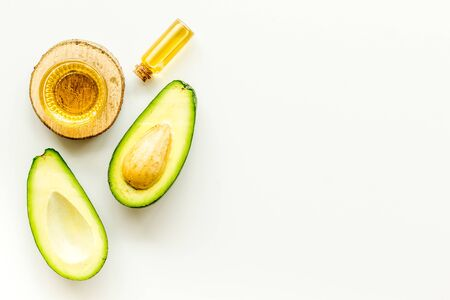 Avocado oil - skin care concept - on white background top-down.