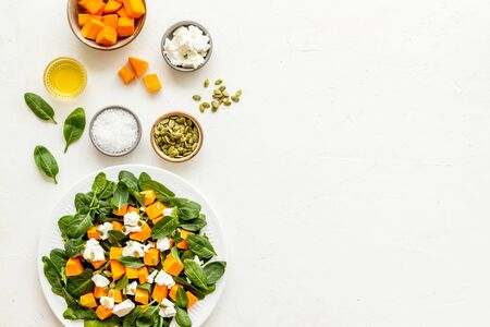 Cooking salad with pumpkin and basil. Ingredients on white background top-down copy space 版權商用圖片