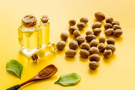 Nutmeg oil - aromatherpy concept - on yellow background