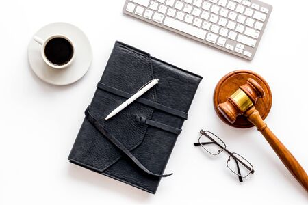 Judge gavel near documents and keyboard - desk of contemporary lawyer - on white background top-down