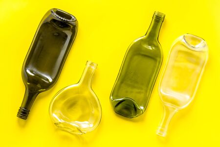 Pattern of bottles on yellow background top view