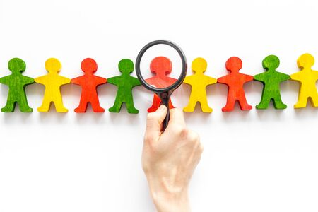 Figures of people on white desk top view. Human resources, hiring and recruitment concept