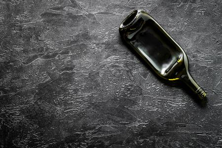Wine bottle on black background top view copy space