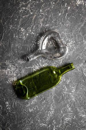 Set of bottles on grey desk top-down