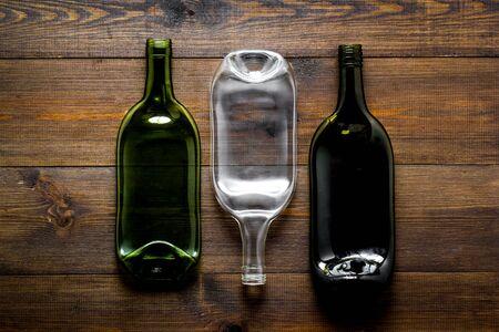 Set of bottles on wooden desk top-down