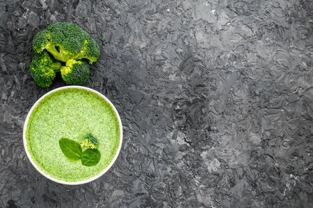 Broccoli soup puree on grey kitchen table top view copy space Stok Fotoğraf