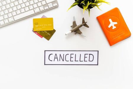 Cancelled flight. Airplane and passport on white background top view