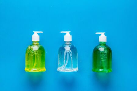 Sanitizer - bottle with dispenser - on blue background top view.