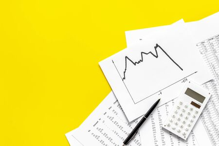 Financail crisis - business grahp, markets crash - on yellow background top-down. Stock Photo