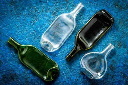 Pattern of bottles on blue background top view