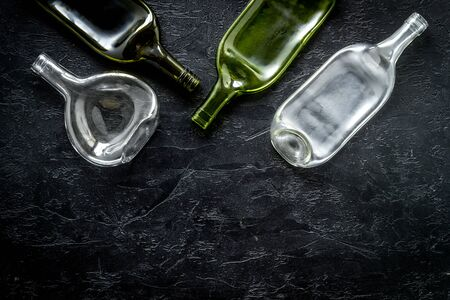 Flat lay with bottles on black table top-down copy space Standard-Bild