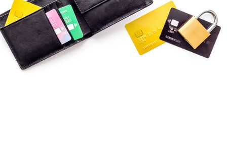 Credit card data security concept with lock on white desk top view copy space Фото со стока