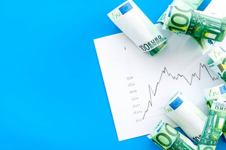 Diagram of stock market prices rates with euro banknote top view