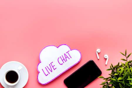 Live chat conversation message concept. Office desktop top view