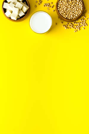 soy vegan food. soy milk and tofu on yellow table from above copy space Reklamní fotografie