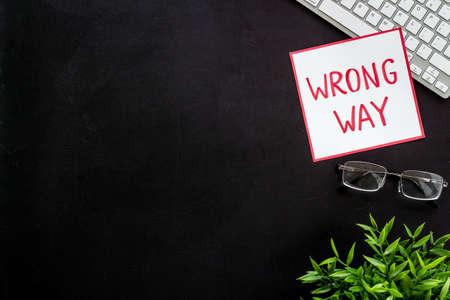 Wrong way icon on office desk - black, top view copy space 版權商用圖片
