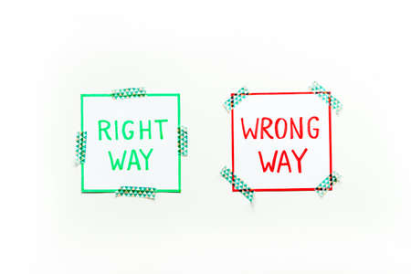 Doubt concept.. Right and wrong way icons on work desk from above