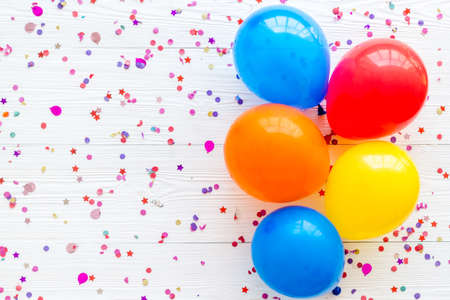 Flat lay with ballons - party concept - on white background top-down copy space