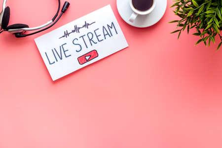 Online streaming social media concept. Paper tablet on office desk top view Banco de Imagens