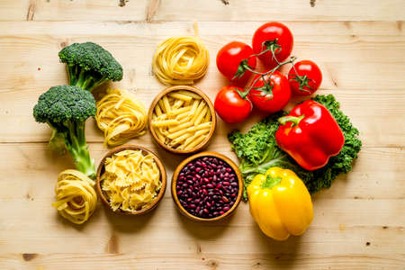 Grocery shopping set with vegetables and herbs, top view Stockfoto