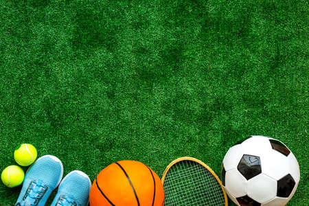 Flat lay of sport balls - football, basketball on grass top view copy space Stock Photo