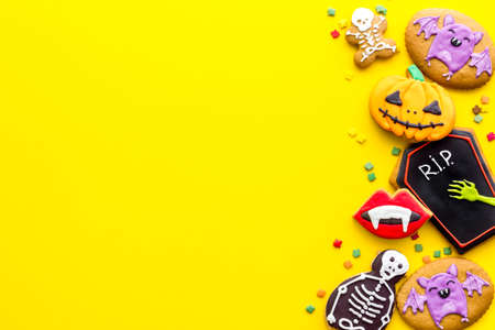Overhead view of Halloween decorations with cookies and candies, top view