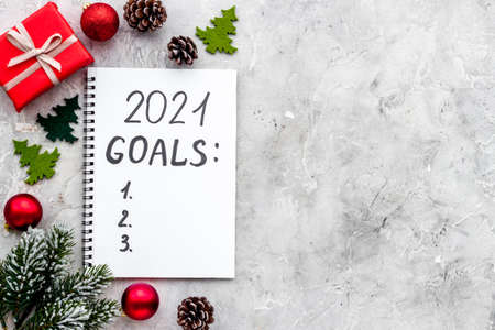 Inspiration concept - New Years goals written in notebook on a table, flat lay