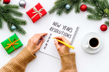 New Year Resolutions. Flat lay with Christmas decorations. Overhead view
