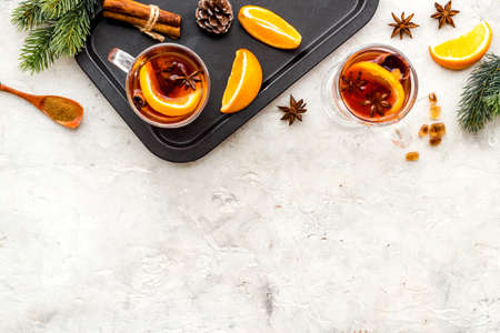Christmas hot drink in glasses - mulled red wine with spices and decoration
