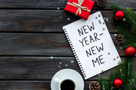 New year - new me. Christmas decorations and notebook on a table, flat lay 版權商用圖片