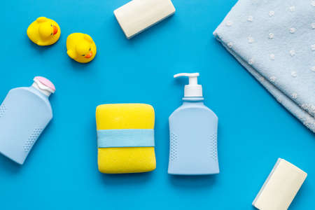 Set of baby hygiene and bath items with shampoo bottle and soap. Top view