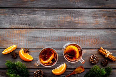 Mulled hot wine with ingredients, top view, copy space