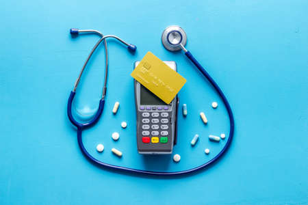 World health day concept. Cost for medicine and treatment, payment by card 版權商用圖片