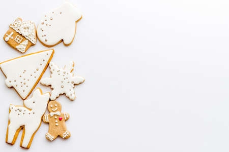 White Christmas cookies with gingerbread men, top view