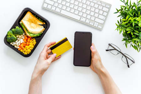 Odering food online delivery to office or home. Luch boxes on workplace