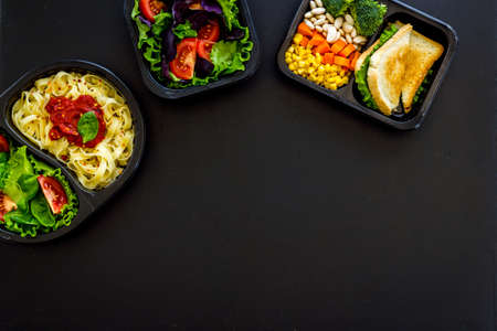Lunch boxes with meal. Food delivery concept. Overhead view