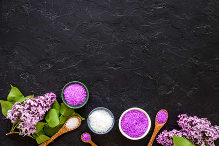 Sea salt spa set with pink lilac flowers. Top view