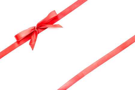 Red ribbon with bow isolated on white. Top view. Copy space