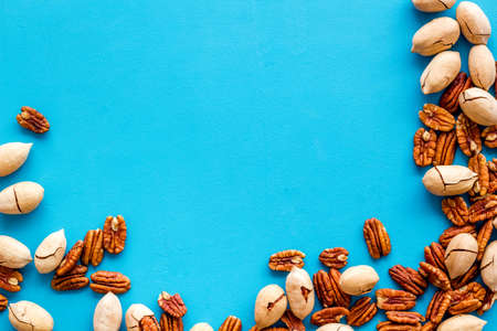 Frame of pecan nuts. Food background, top view
