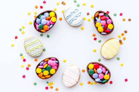 Happy Easter frame of cookies eggs and sweets, top view