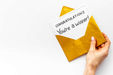 Award letter You Re A Winner in golden yellow envelope. Congratulations concept