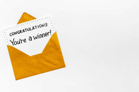 You are a winner. Golden envelope with congratulation card. Top view