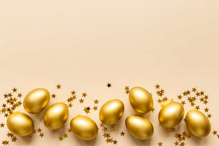 Golden Easter eggs with decoration. Wealth and good luck concept.